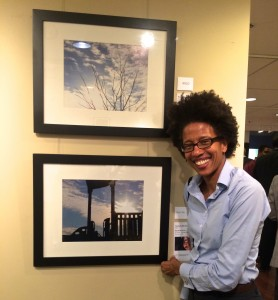 Traci Higgins showcases her newly purchased work of art- an original photograph by Shootback photographer Navell Shreeves, a third-grader at Thomas Elementary School in Washington, DC.